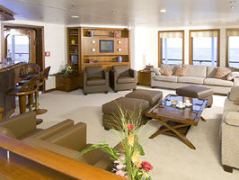 The bar and lounge on main deck is a popular place with guests